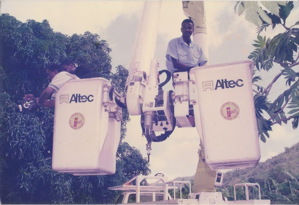 """Community Support!! APUA """"bucket truck"""" was our crane! (July 2000)"""